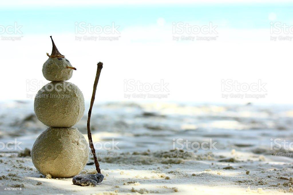 Sandman mit blauen Meer Hintergrund Lizenzfreies stock-foto