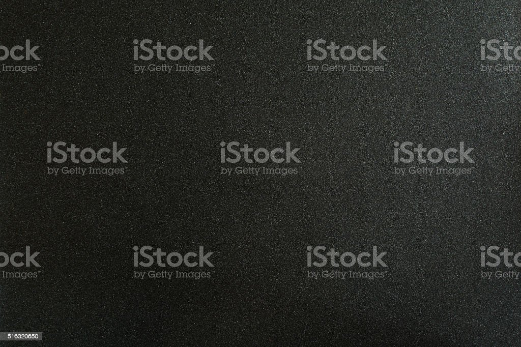 Sandpaper surface and dark texture background stock photo