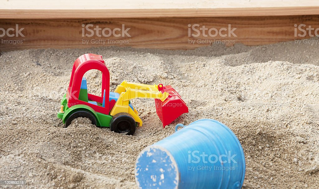 Sandpit with toys royalty-free stock photo