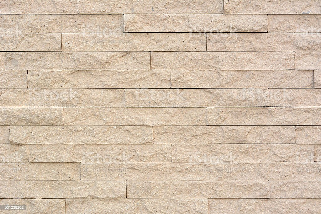 Sandstone brick wall texture background stock photo