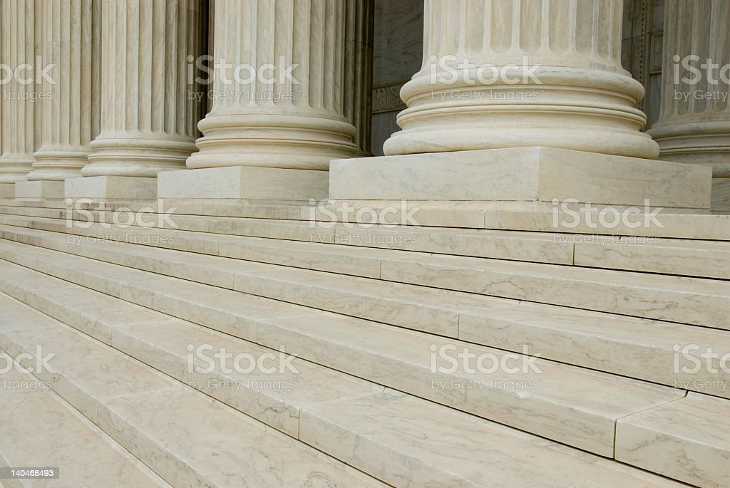 Sandstone building's pillars pictured from the steps stock photo