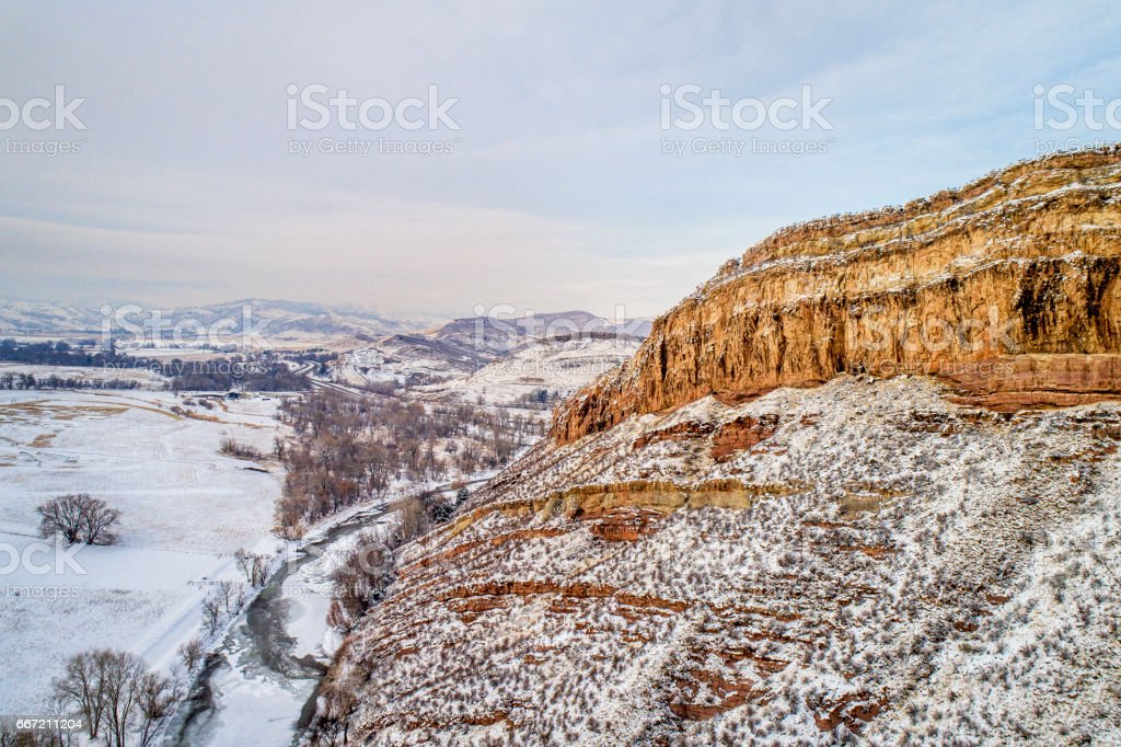 sandstone cliff and river aerial view stock photo