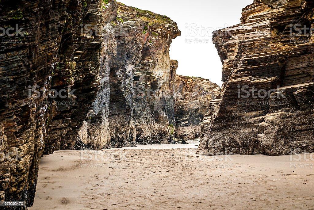 Sandstone cliff on a sandy beach in Atlantic ocean Spain. stock photo