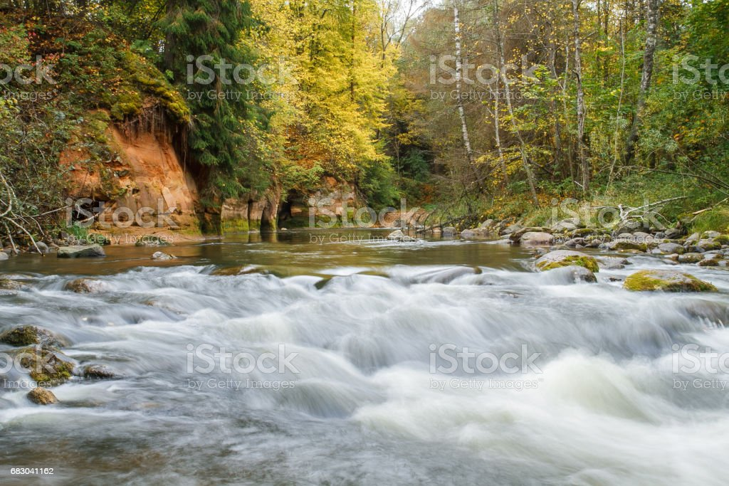 Sandstone cliffs on the river shore in the Gaujas National Park. 2012 stock photo