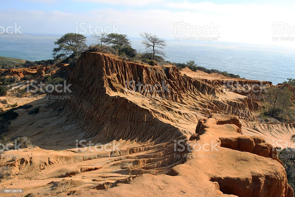 Sandstone cliffs with the ocean in the background stock photo