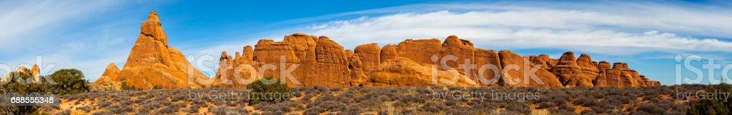 Sandstone fins. Red rock formation in Devils Garden, Utah, USA. XXXL stitched panorama. stock photo