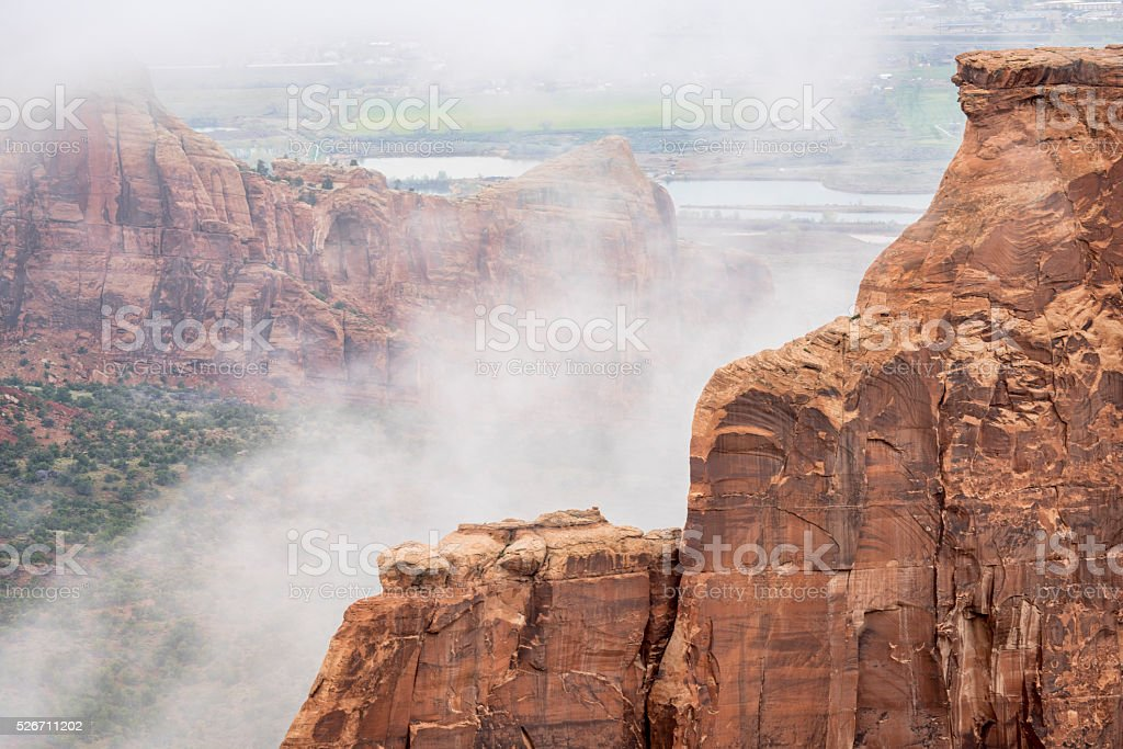 sandstone formations in fog stock photo