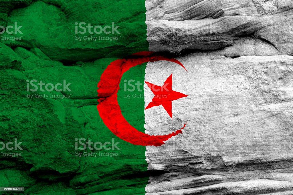 Sandstone rock and flag of Algeria stock photo