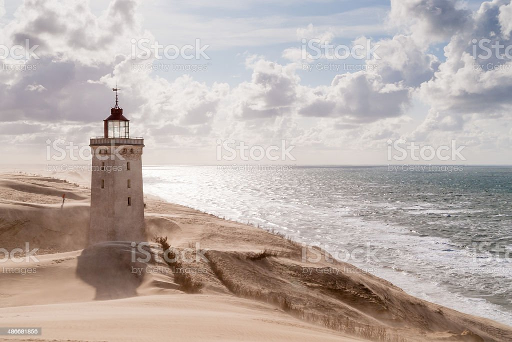 Sandstorm at the lighthouse stock photo