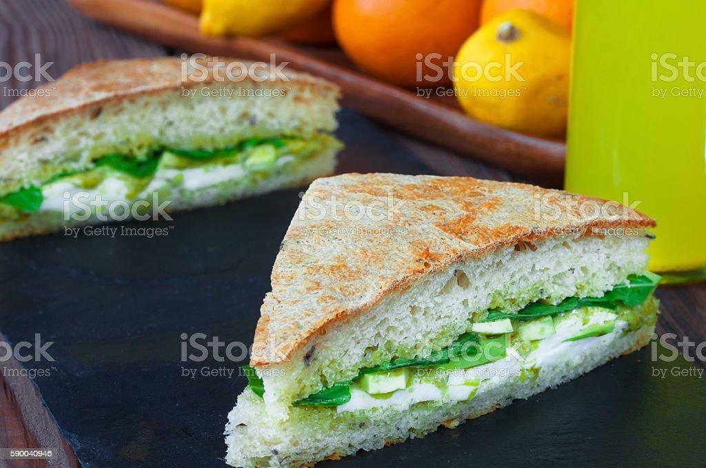 Sandvich with mozzarella cheese and pesto sauce stock photo