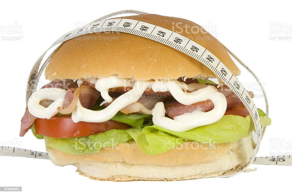 Sandwich and tapemeasure royalty-free stock photo