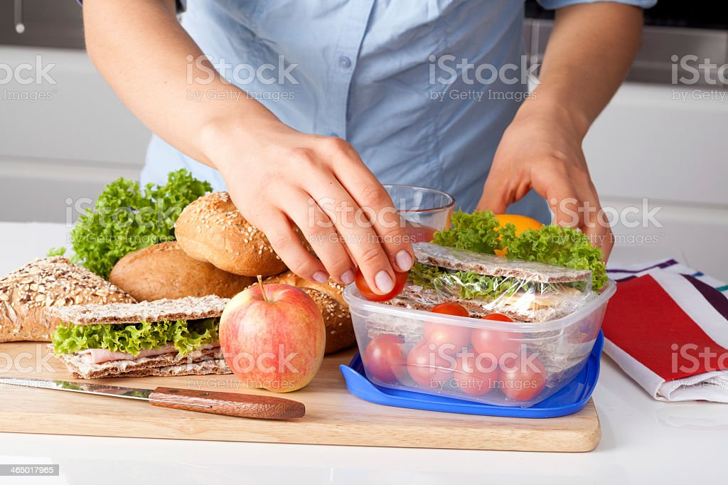 Sandwich being prepared on a cutting board stock photo