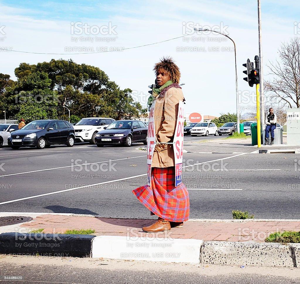 Sandwich board woman acts as human billboard stock photo