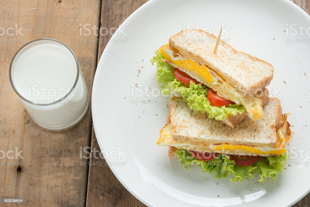 Sandwich fried egg with cheese and milk. stock photo