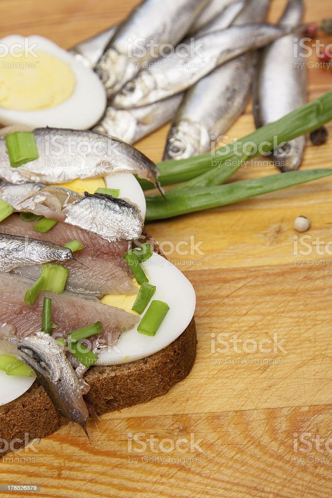 sandwich from salted anchovies with egg and spring onion royalty-free stock photo