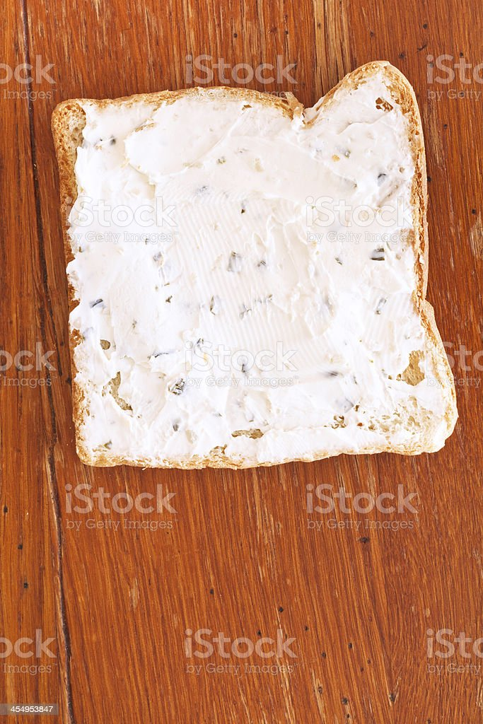 sandwich from toast and soft cheese with herbs stock photo