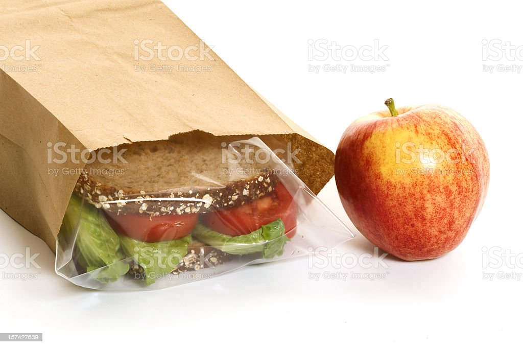 Sandwich in a bag with an apple on the side royalty-free stock photo