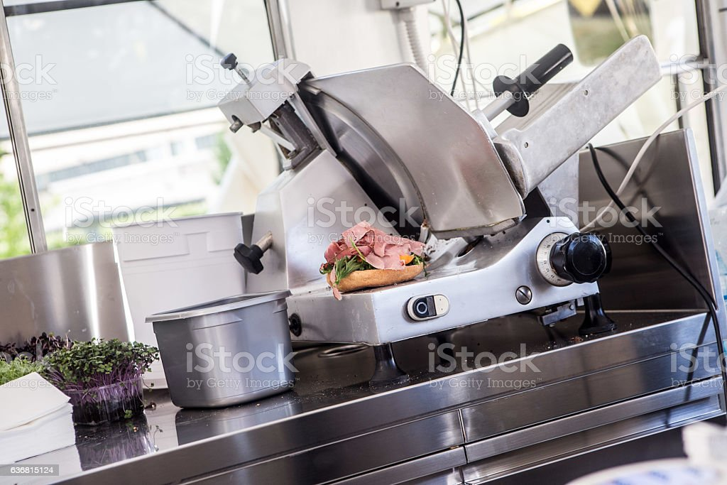 Sandwich is ready on the slicer stock photo