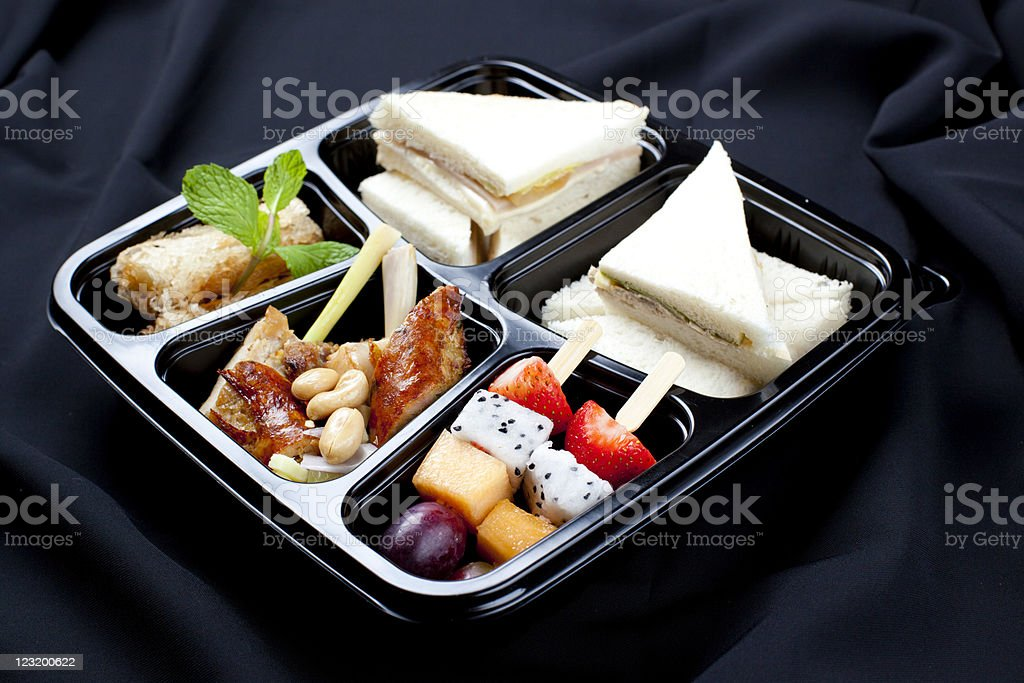 Sandwich, meat and salad in take out bento box royalty-free stock photo