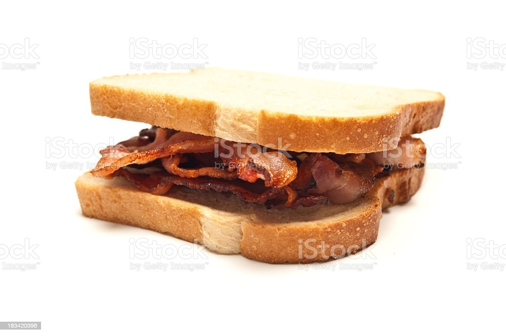 Sandwich of bacon strips between two slices of white bread royalty-free stock photo