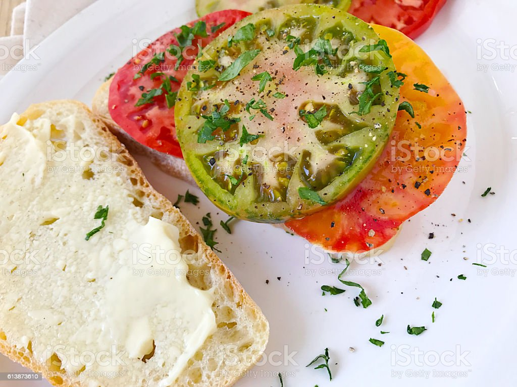 Sandwich of heirloom tomatoes with black pepper stock photo