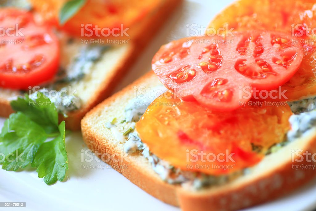 Sandwich of heirloom tomatoes with cilantro mayonnaise stock photo
