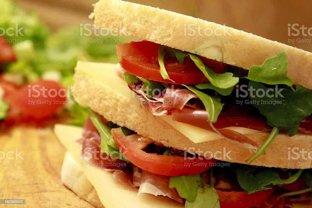 Sandwich of prosciutto, Gruyere, tomato and rocket royalty-free stock photo
