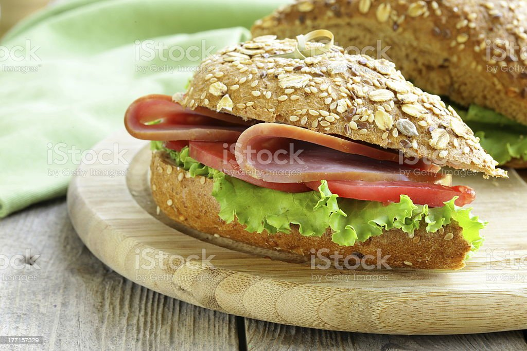 sandwich of wholemeal bread with ham and tomatoes royalty-free stock photo