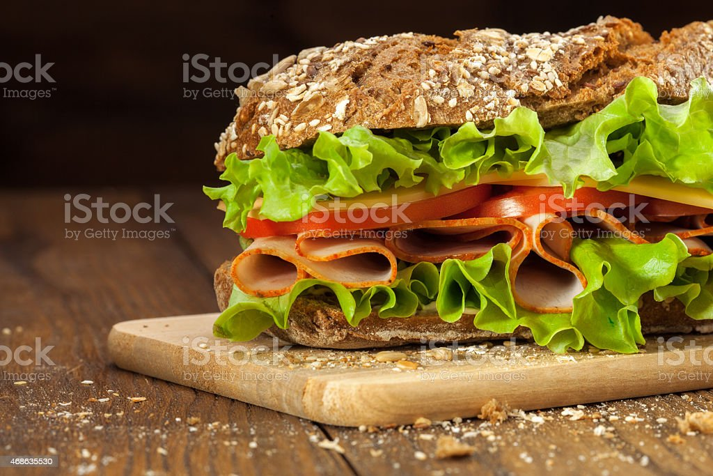 Sandwich on the wooden table stock photo
