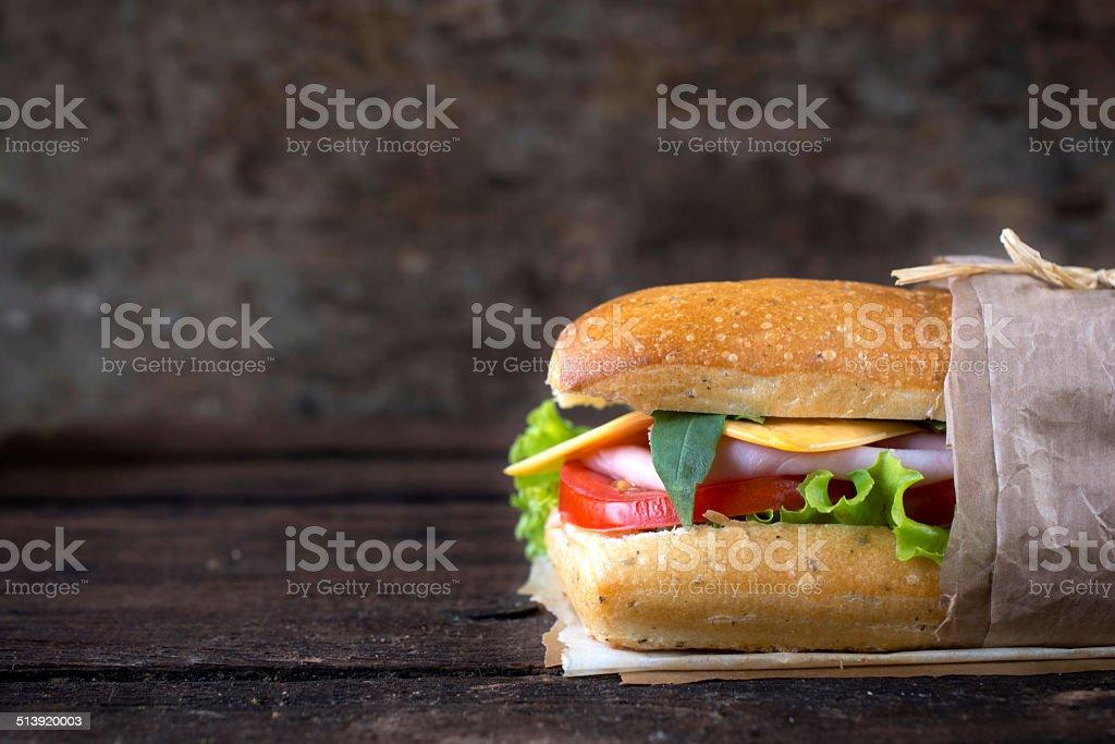 Sandwich on wooden background stock photo