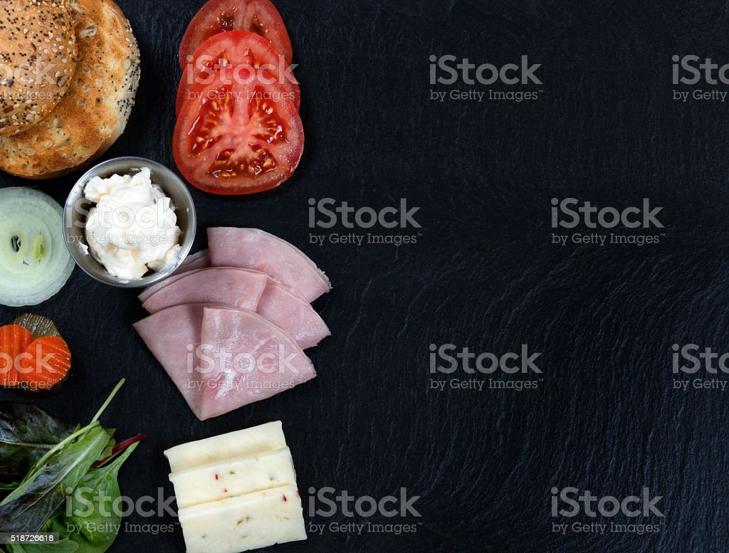 Sandwich ready to be made with fresh ingredients on slate stock photo