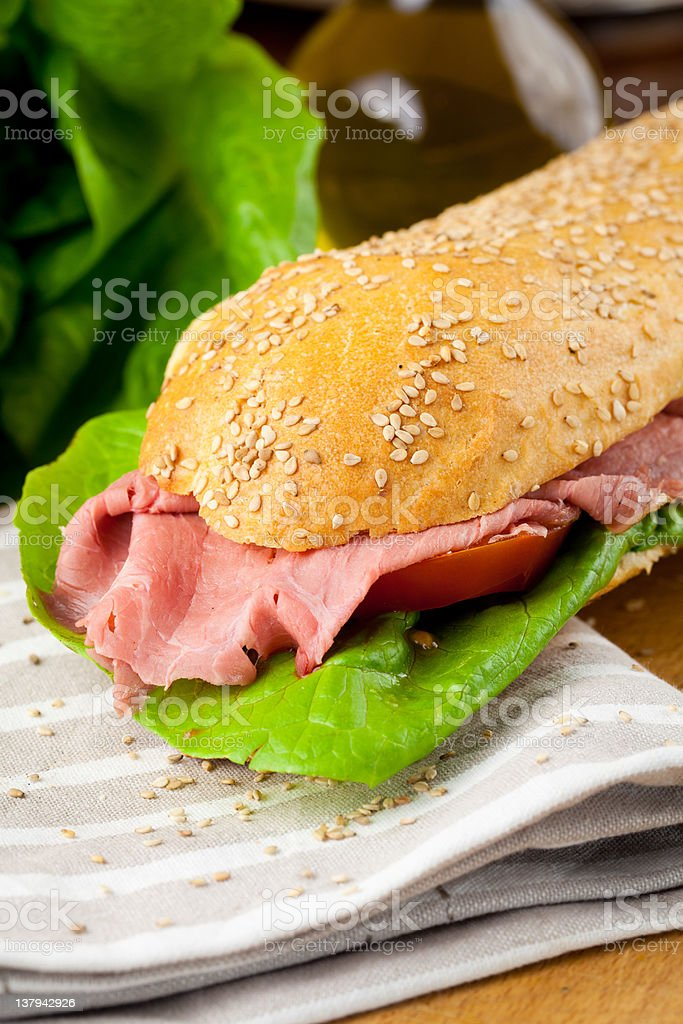Sandwich roast beff, lettuce and tomatoes royalty-free stock photo