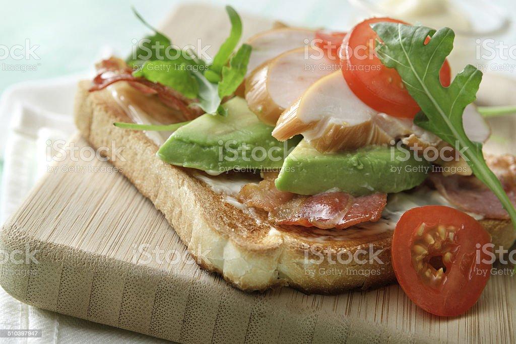 Sandwich Stills: Smoked Chicken, Avocado, Bacon, Arugula and Tomato stock photo