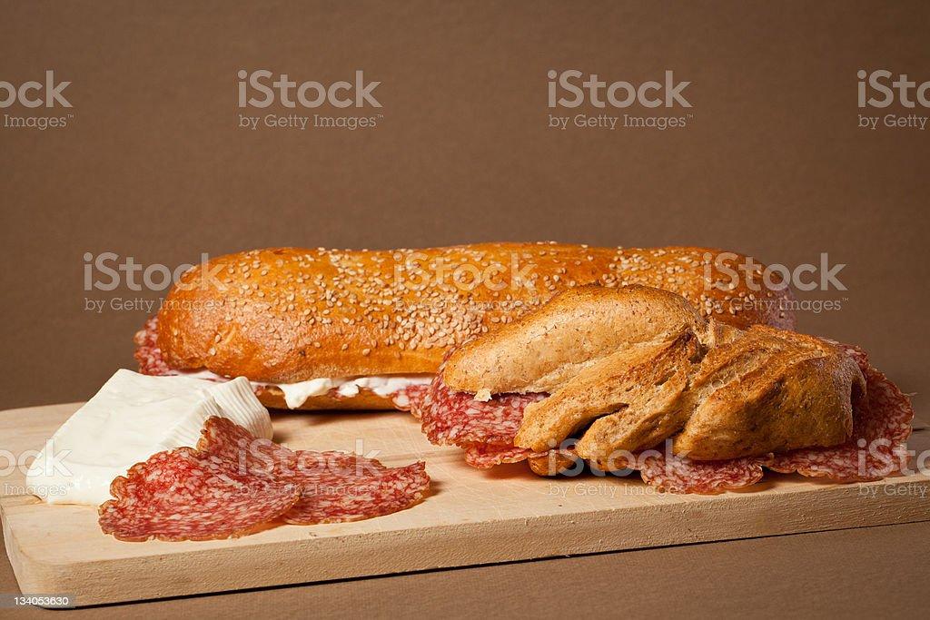 Sandwich wit italian salami and fresh cheese stock photo