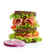 Sandwich with a rye bread, ham, cheese and tomatoes