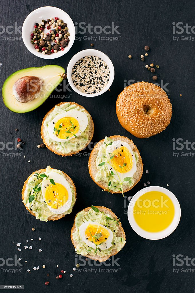Sandwich with avocado and eggs stock photo
