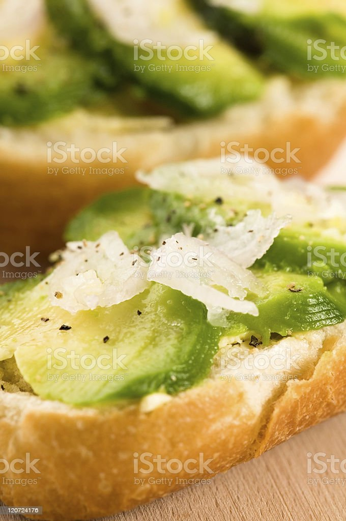 Sandwich with avocado on a wooden board royalty-free stock photo