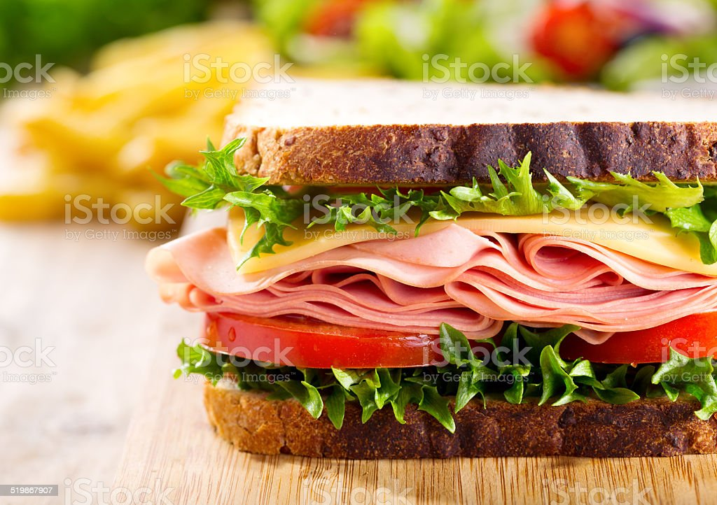 sandwich with bacon and vegetables stock photo