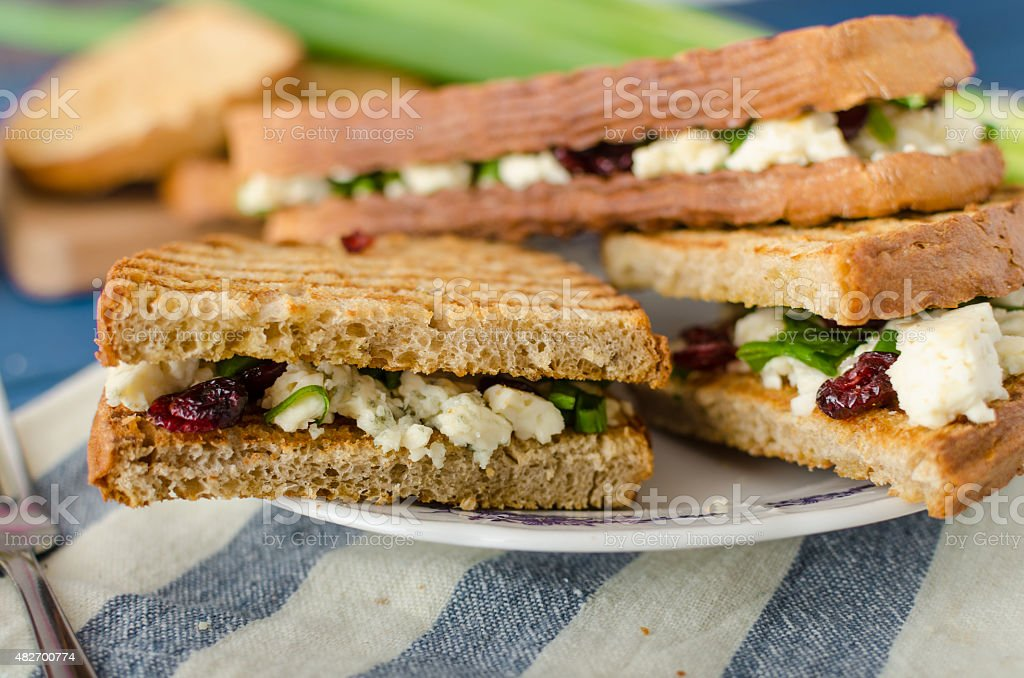 Sandwich with blue cheese and cranberries stock photo