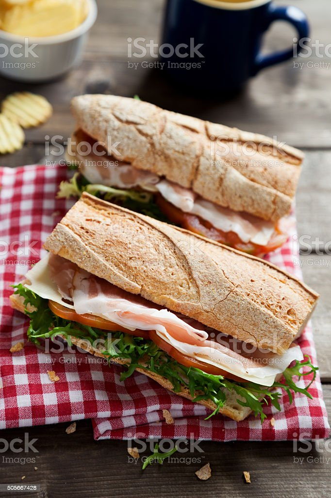 sandwich with cheese prosciutto and salad stock photo