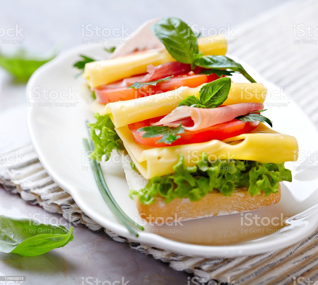 Sandwich with cheese,prosciutto crudo and vegetables royalty-free stock photo