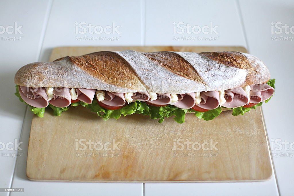 Sandwich with chicken salami, tomatoes, salad and mayonnaise stock photo
