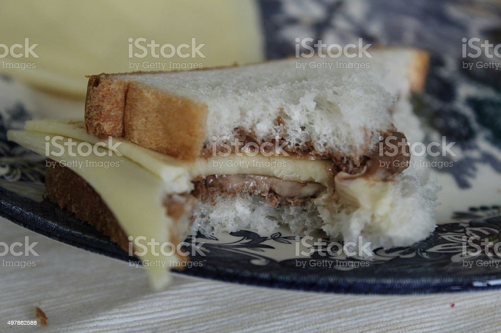 Sandwich with chocolate cream and cheese slices. stock photo