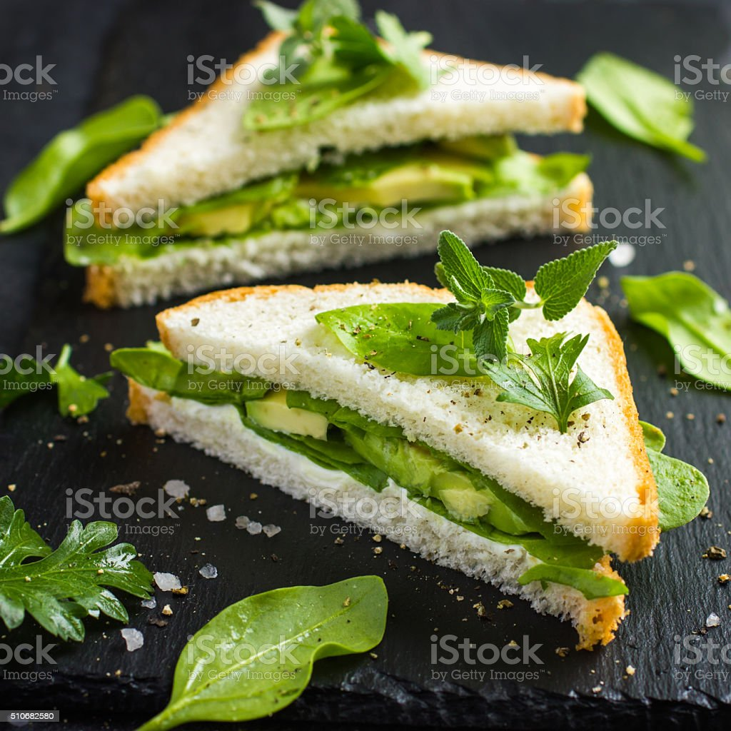 sandwich  with cream cheese, avocado and spinach stock photo