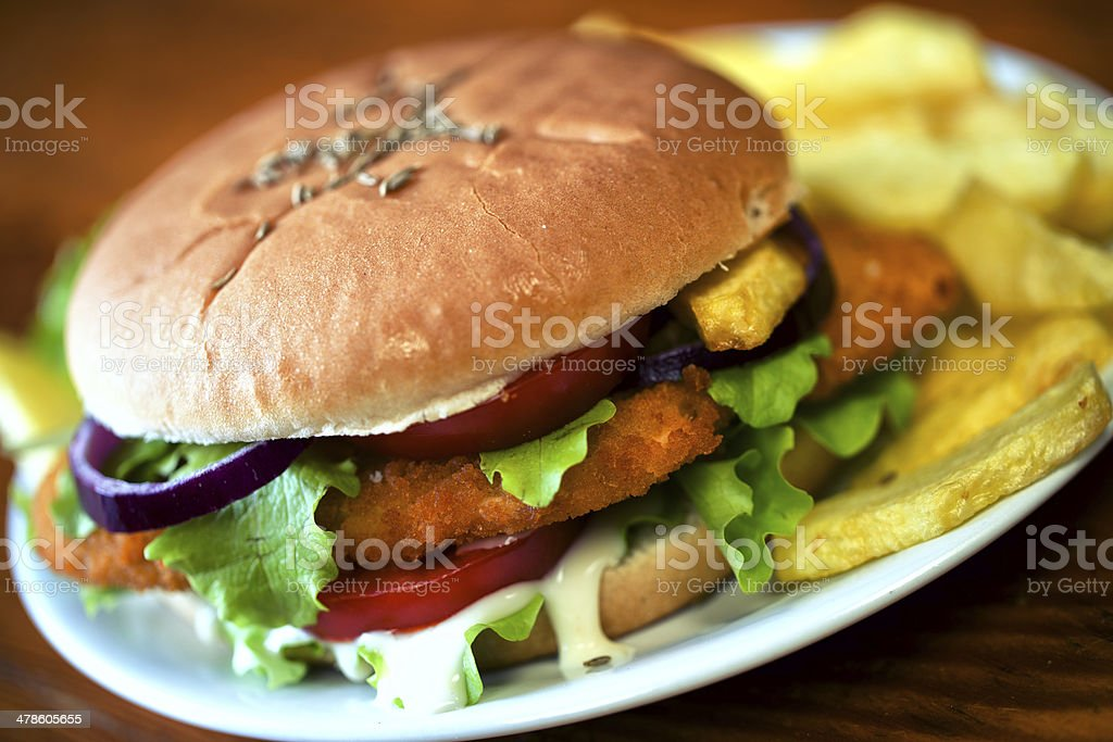 Sandwich with cutlet and fried potatoes stock photo