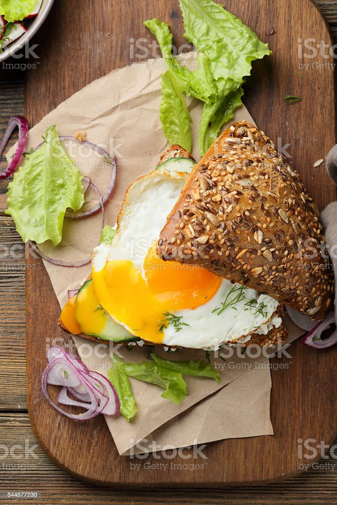 sandwich with fried eggs and salad stock photo