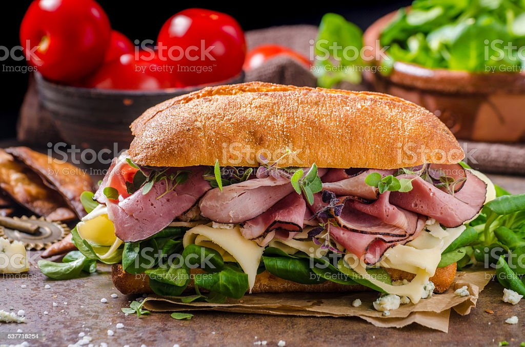 Sandwich with ham and cheese, lettuce stock photo