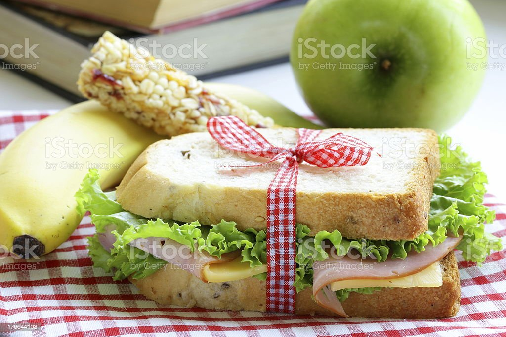 sandwich with ham, apple, banana and granola bar stock photo