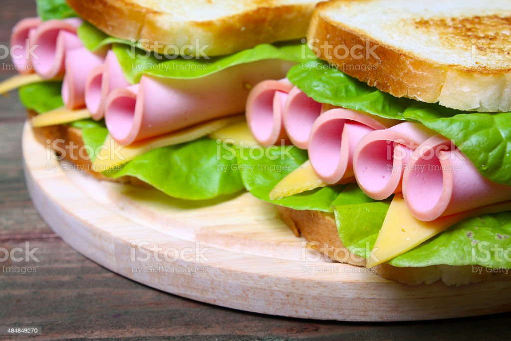 sandwich with ham, cheese and lettuce stock photo