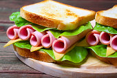 sandwich with ham, cheese and lettuce